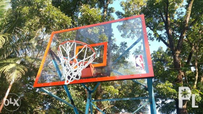 Basketball fiberglass board with snap back ring net