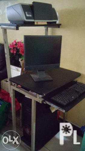 Computer desktop with printer and computer table