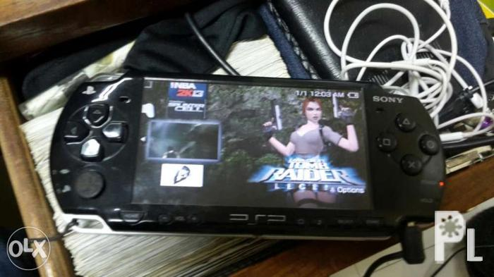Psp fat with 8 gig memory and 6 games