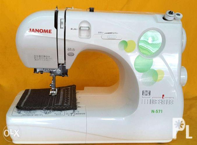 singer sewing machine with overlock janome for sale in manila national capital region. Black Bedroom Furniture Sets. Home Design Ideas