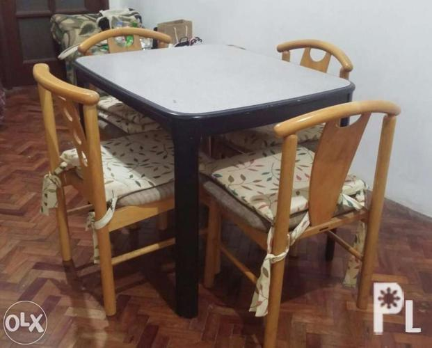 Sturdy Dining Table With Chairs And Pillows