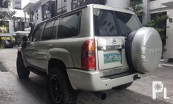 """2007 Nissan patrol super safari 4x4 gasoline automatic transmission intact leather interior leather 2""""lift ridemax shocks louvell coil springs 20's mags with mud terrain tires snorkel 45tkms very fresh"""