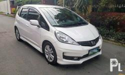 2012 Honda Jazz 1.5 2012 Honda Jazz 1.5 1st owner All stock all working Top of The Line A/T smooth shifting Orig Taffeta White Paint smooth and shiny 2pcs. original keys Complete and clean legal documents
