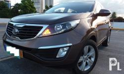 Kia Sportage EXA TSportronic +/-2.0L CVVT  GasFuel  Efficient All Power Dual SRS Airbag Cruise Control 1st Owned Very Fresh Foglamps Integrated audio system Roof RailRain Visor3m Tint Alarmkeyless Entry Rear Spoiler Tonneau Cover HID Headlamps High/Low
