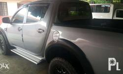 2012 Mitsubishi Strada GLX 2.5 Liter Turbo Diesel, Manual Transmission Silver Grey Color Features: 17� Original Black Rhino Alloy Mags Black leather-covered seats Goodyear Wrangler Tires. 95% thread life V-Kool Tint (front, rear, and side windows) Rear