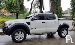 2013 Ford Ranger XLT White 2013 Ford Ranger XLT 2013 Year 90,000 km mileage 2.2L Engine Diesel Fuel Automatic transmission Air Conditioning Cruise Control Power Steering Electric Windows Leather Interior Air Bags Alarm Anti-Lock Brakes (ABS) Fog Lights