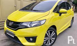2015 Honda Jazz 1.5 VX Automatic  Good as new! All option Econ Mode Sportmode +/- paddleshifter Pushstart keyless 2 original Smart key Color: Attract Yellow (limited color) 10.+++km Mileage  Dual Airbag Optitron Gauge Audio Steering control Touchscreen HU