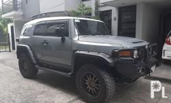 2015 Toyota Fj cruiser AT fully loaded straight focal sounds pioneer stereo 20s black rhino with nitto tires vkool tint etc.. cement gray
