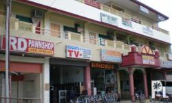 LAGULAY COMMERCIAL BUILDING Corner Ledesma St. & Jaycee Ave., City of Tacurong Tel. No.: (064) 477-0226 Floor Area: 2nd Floor, approx. Forty Five (45) sq.m. Location: prime commercial area, near dept. store, city public market, hospitals/clinics,