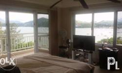 Four-story 357 sqm dream house overlooking Subic Bay. Six bedrooms, 4 bathrooms and gym plus maid's room with bathroom. Clear freehold title on lot in a gated community 1000 meters from Subic City. Eight inverter split-system air conditioners. Aluminum