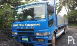 Kondisyon: Gamit na TEN WHEELER TRUCK for sale FUSO SUPERGREAT DROPSIDE slightly used ENGINE#: 6D24-258328 CHASSIS #: FT51VX-50021 slightly used double differential all tires new in good running condition contact# 0929-601-3873