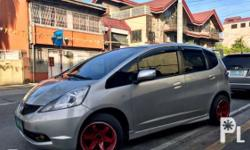 "1.3L automatic Dual airbags 4 wheel disk brakes Updated registration Fresh paint (orig, shiny, no scratches) Fresh interior (walang punit, everything intact) Super cold A/C All lights working All lights on gauge working  15"" TE37 concave mags with thick"