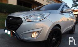 "Hyundai Tucson Theta II GLS A/T Sportronic +/- 2.0L CVVT Gas Fuel Efficient All Power Dual SRS Airbag Cruise Control   1st Owned Very Fresh   New 18"" Magwheels Over Rider Chrome Trims Foglamps Integrated audio system Roof Rail Rain Visor 3m Tint Alarm"