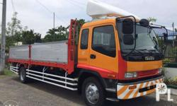 CODE: U3 Pls use the code when inquiring be wise buy direct! Japan surplus .. Isuzu Forward 8 Stud Aluminum Drop side 6HH1 engine FTR chassis 24 ft. body, steel flooring Leaf spring Brand new dashboard Color: Yellow Original 9,000 kms mileage from Japan