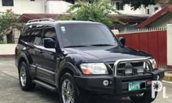 Mitsubishi Pajero US version 2005 Year 103,000 km mileage 2.5L Engine Gas Fuel Automatic transmission Air Conditioning Power Steering Remote Keyless Entry Sunroof Leather Interior Air Bags Alarm Anti-Lock Brakes (ABS) Fog Lights AM/FM Radio CD Player