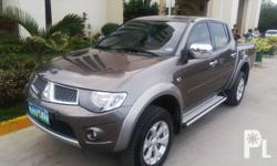 MITSUBISHI STRADA GLS SPORT-v 4x4 2013 Diesel Engine M Transmission 2.5 Engine Displacement ABS brake Dual airbag touch screen stereo DVD Stereo USB Stereo backing sensor  Backing camera 6 holes