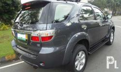 Toyota Fortuner G Diesel AT Make:Toyota Model:Fortuner Year:2011 Color:Gray Engine Type:Diesel Transmission:Automatic