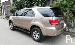 Toyota Fortuner V 4x4 3.0 D4D diesel Automatic transmission Orig Gold Metallic color paint smooth Nice interior Cool dual aircon Good suspension 80% tires All stock good condition Fabric interior Complete papers Not flooded no accident