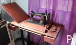 This Singer sewing machine is in original condition.