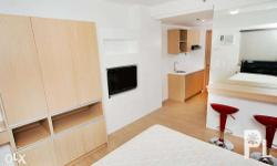 Semi-furnished unit at M Place condominium, which