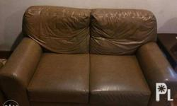 selling my parent's 2 seat leather sofa! no holes or