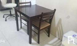 2 seater dining table looking like new dark brown