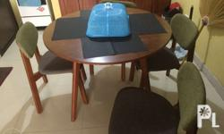 Four seater round table. Excellent wooden design table.