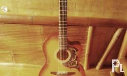 i'm selling my acoustic guitar for only 2,000, used for