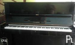 S.Schimmel Acoustic piano in a good condition with free