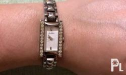 Silver tone rectangle dial watch with stones