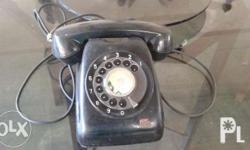 Antique black dial phone used during the 90's. This is