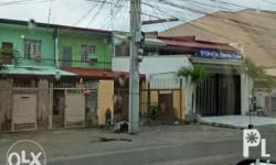 One unit two-storey apartment building with fence and