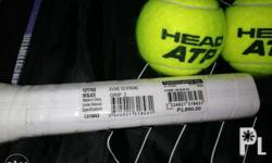 Babolat Racket with two pieces of Tennis Ball Head