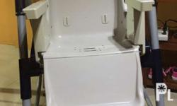 Sturdy baby high chair. Comes with 2 trays (white and