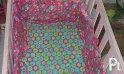 Pink sturdy wooden crib for baby girl. With uratex