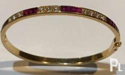 one (1) bangles mounted in 18 carat gold round design