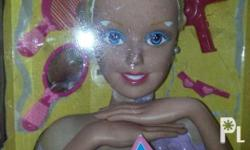 good condition half size barbie doll with accessories