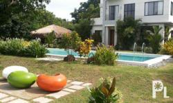 Calayo beach house features a beautiful cove with