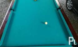 This is a senior size drop pocket billiard table. The