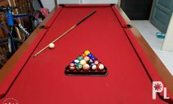 You are buying a 2nd hand Billiards table with red