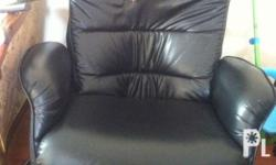 Black reclining chair, massage machine is busted. With