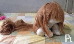blonde wig, with bangs, and side hair. curly ends taiga