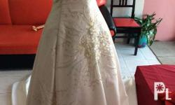 Selling a brand new beautifully beaded wedding gown.