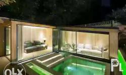 Design ideas for a contemporary custom-shaped pool with