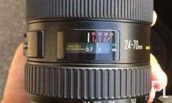 Selling my Canon 24-70. With Cap front and back and