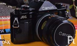 Canon A1 with 50mm 1.4 FD and Tamron 75-250mm Adaptall