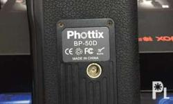 phottix battery grip for canon 50d with free battery.