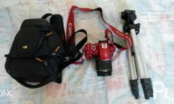 Red Canon 1100D Dslr Camera with tirpod and camera bag