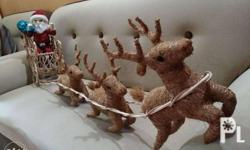 Cute Santa in a Sleigh with 3 Reindeers. Made from