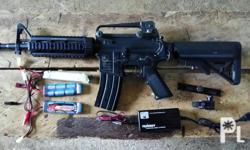M15A4 Carbine airsoft rifle. Used it for pesky pets.